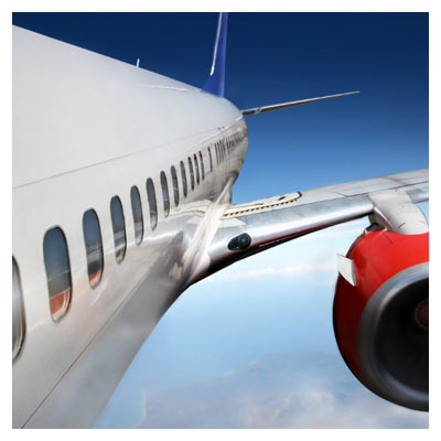 دانلود عکس با کیفیت از هواپیما در حال پرواز بر فراز ابرها (airplane flight Stock Photo)