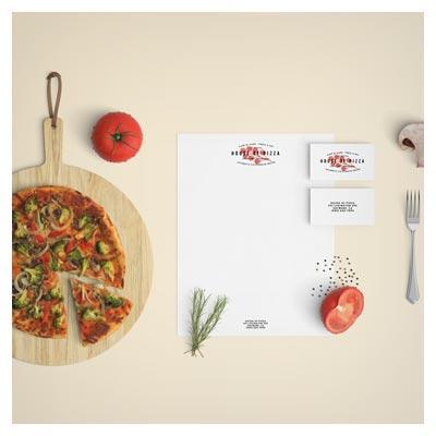 موکاپ سربرگ و کارت ویزیت در کنار مواد غذایی (پیتزا)