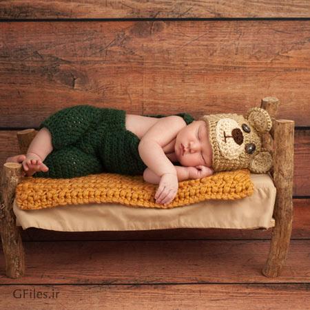 دانلود تصویر با کیفیت از نوزاد خوابیده رو تخت فانتزی