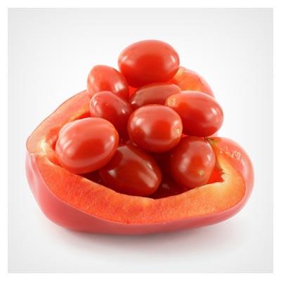 گوجه فرنگی های کوچک و زیبا در یک نصفه فلفل دلمه قرمز رنگ