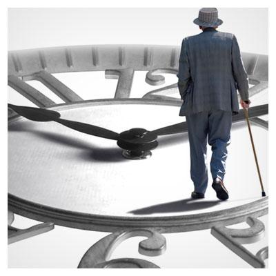 عکس یک ساعت بزرگ که پیرمرد عصا به دست بر روی آن راه می رود