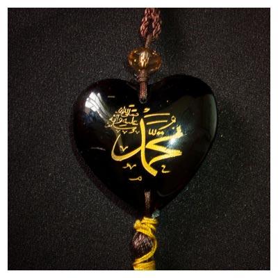 عکس آویز حضرت محمد(ص) مشکی رنگ در زمینه تیره
